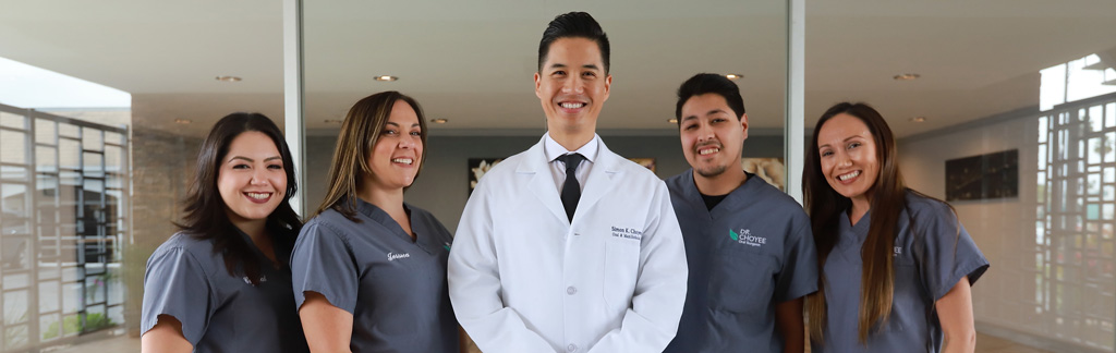Dr. Simon Choyee with his staff