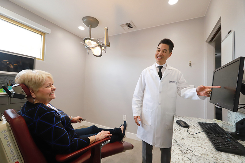Dr. Choyee consulting a patient about reconstructive surgery procedure after their Biopsy at Simon K. Choyee, DDS, Inc.