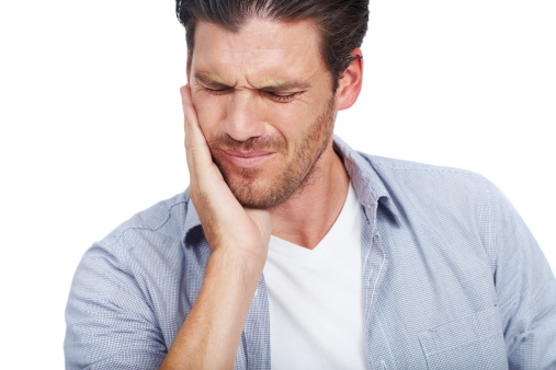 Image of a man holding his broken jaw. Learn about diagnosis and treatment at Dr. Choyee, Oral Surgeon in Whittier, CA.